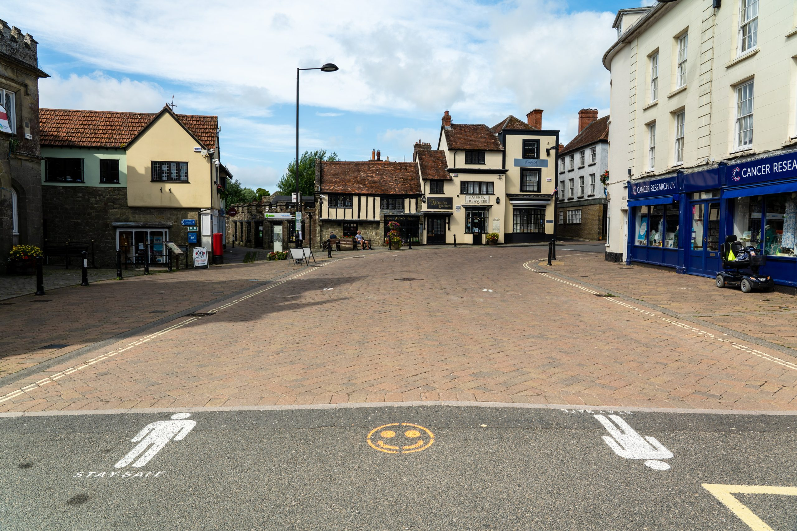 High Street in Hertfordshire with social distancing markers painted on the floor